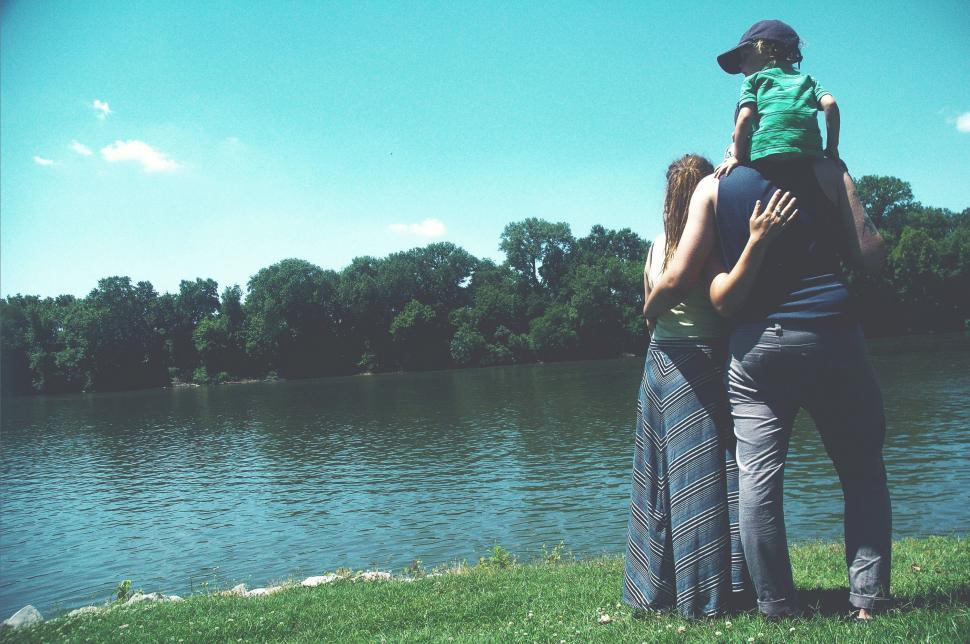 Download Free Stock Photo of Back Side View of Couple With Child Standing by the River