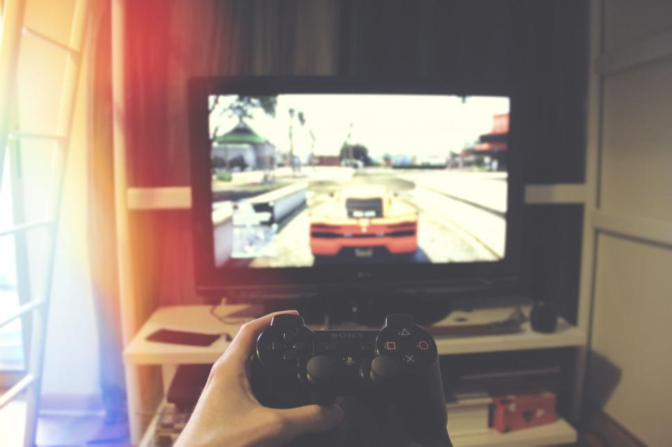 Download Free Stock Photo of Playing on the console