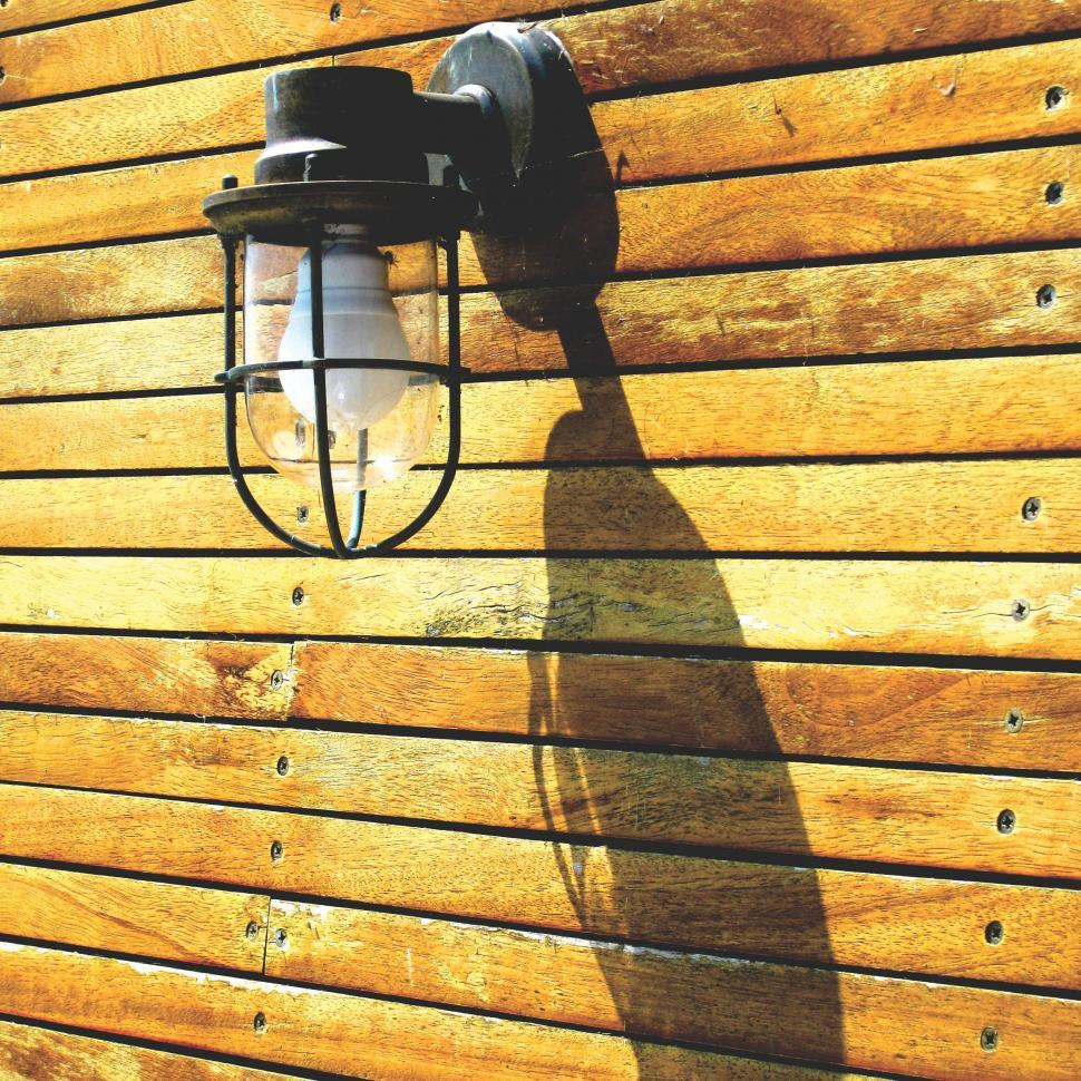 Download Free Stock Photo of Lamp on wooden wall