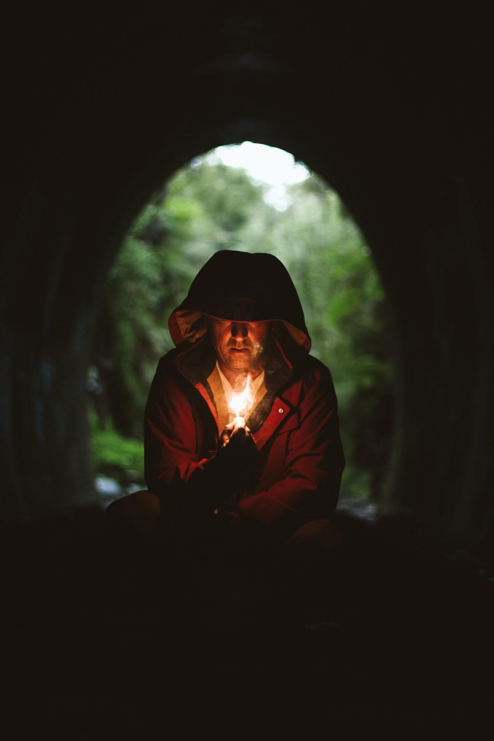 Download Free Stock HD Photo of Hooded Man in Cave with candle light  Online