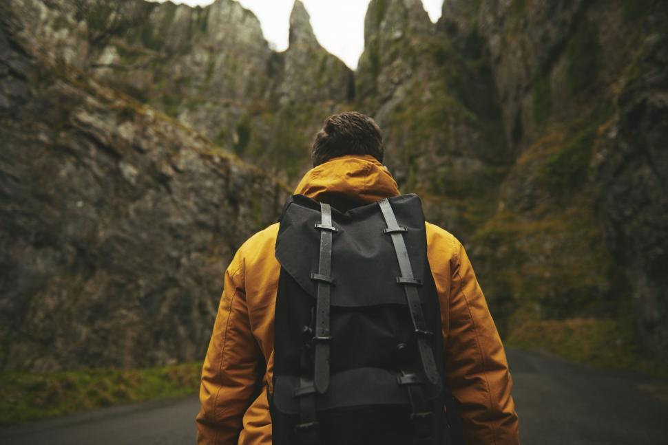 Download Free Stock Photo of Back Side view of Hiker on mountain road