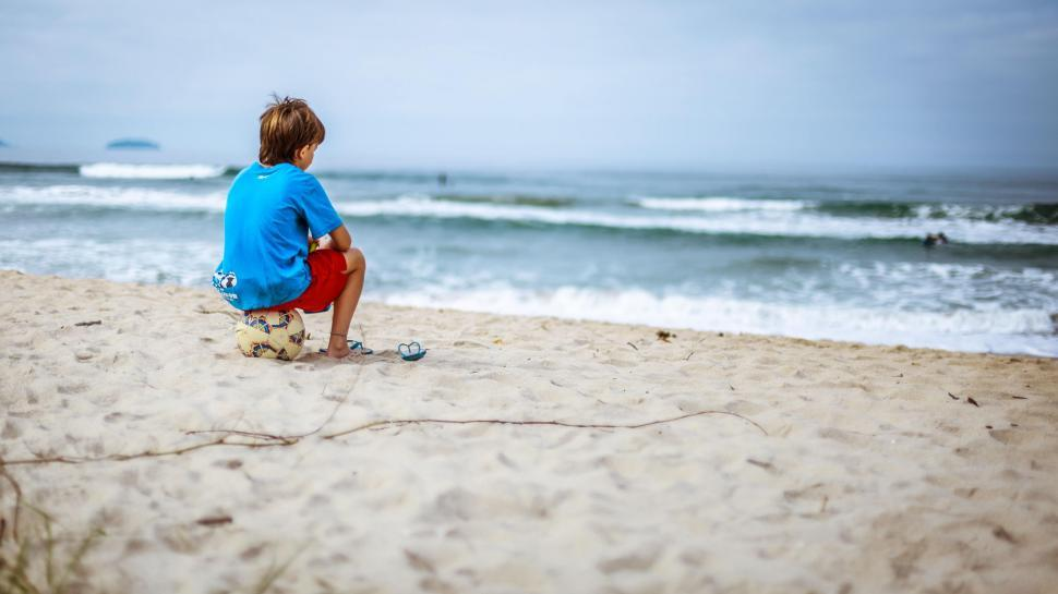 Download Free Stock Photo of Boy at beach with football