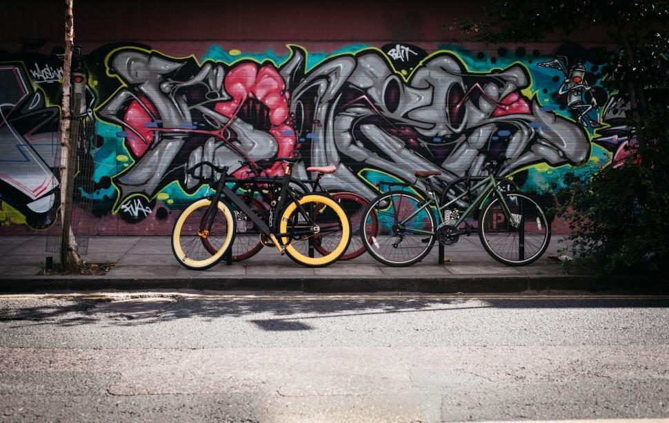 Download Free Stock Photo of Graffiti wall and bicycles