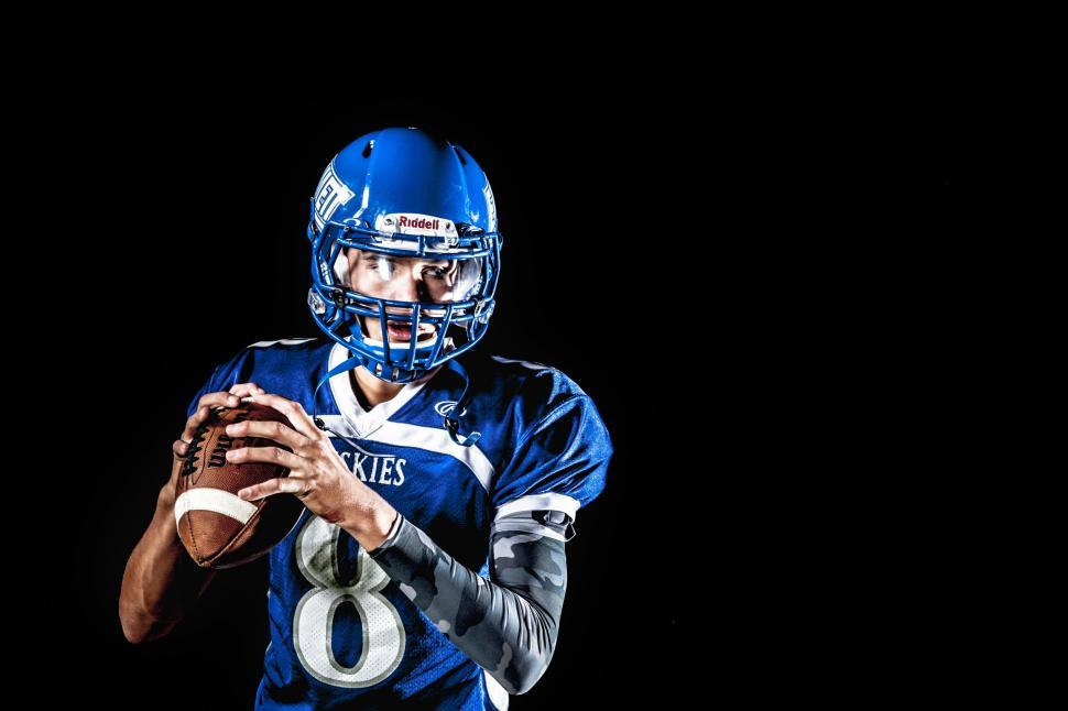 Download Free Stock Photo of American football player in helmet on black background