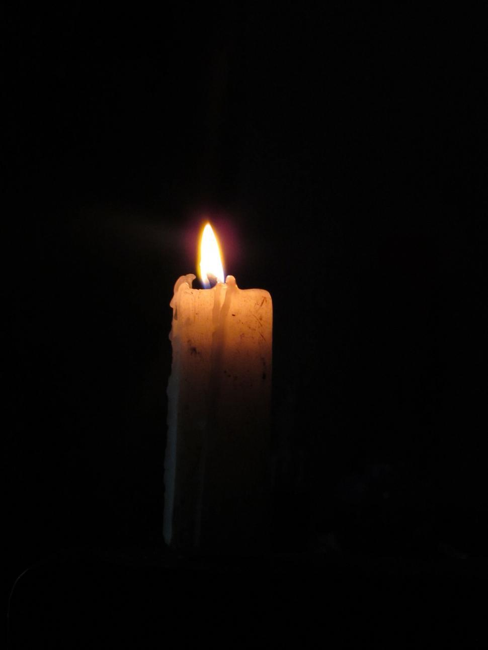 Download Free Stock Photo of Candle light on black background