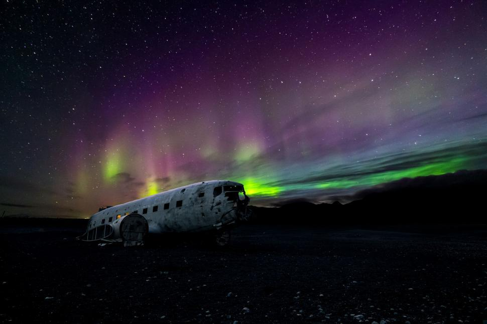 Download Free Stock HD Photo of Northern lights over plane wreckage, Iceland Online