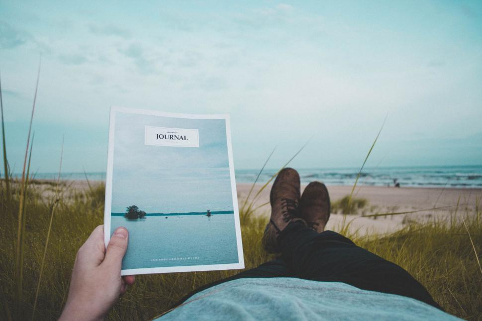 Download Free Stock Photo of Reading Journal at beach