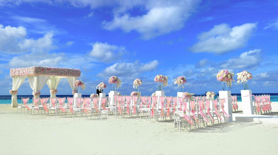 Download Free Stock Photo of Beach Wedding Set up with blue sky