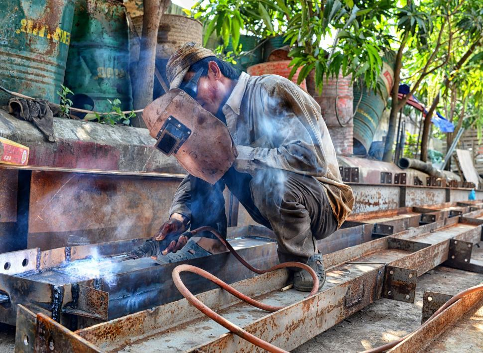 Download Free Stock Photo of Welder at work