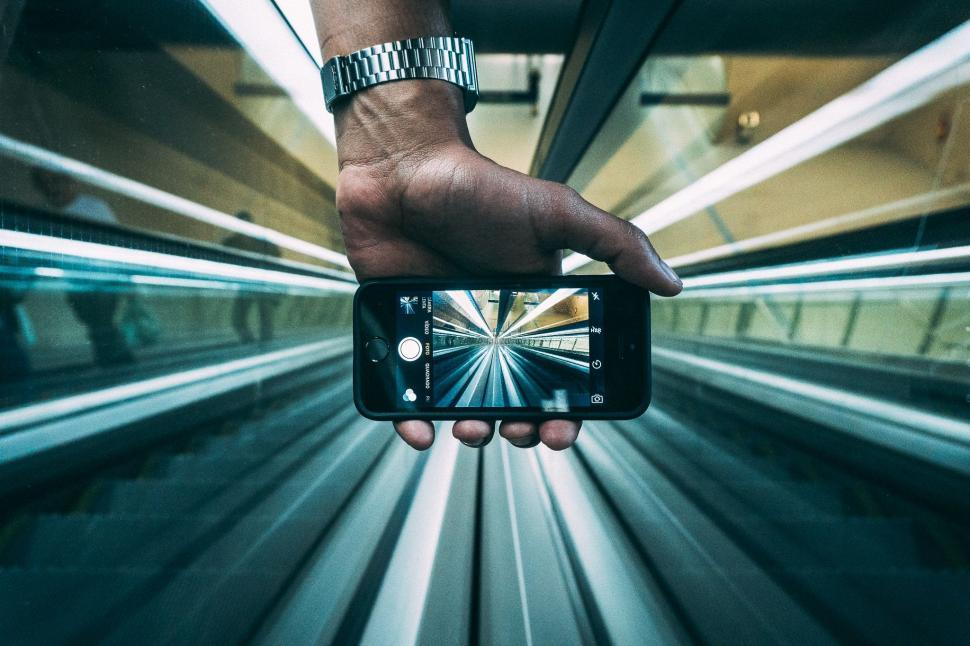 Download Free Stock Photo of Taking picture of escalator with smartphone