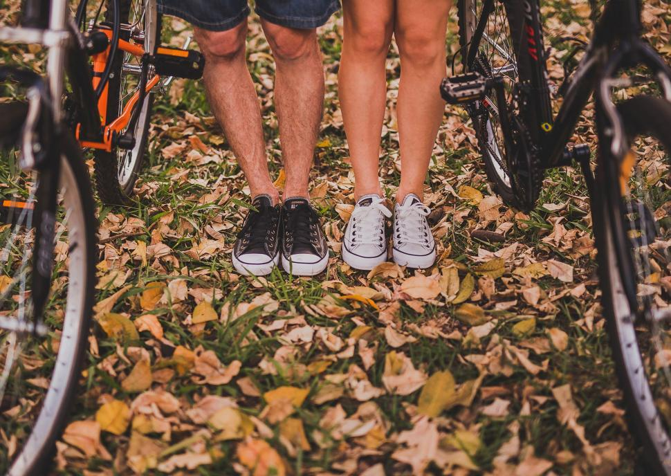 Download Free Stock Photo of Couple Shoes on Autumn Leaves