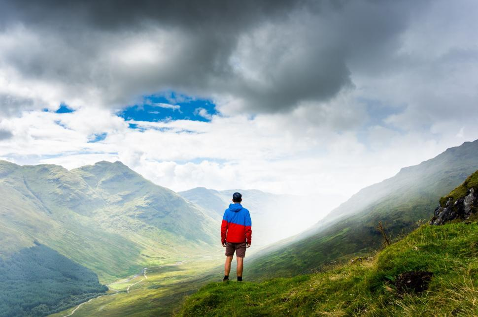 Download Free Stock Photo of Lonely Man on Green mountain