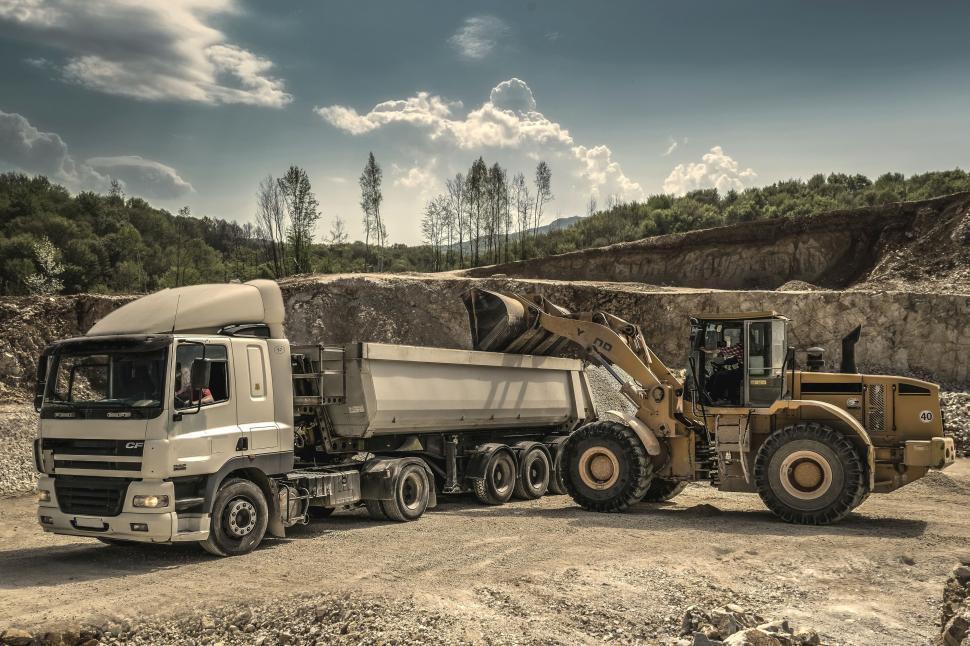 Download Free Stock Photo of Excavator machine and Truck