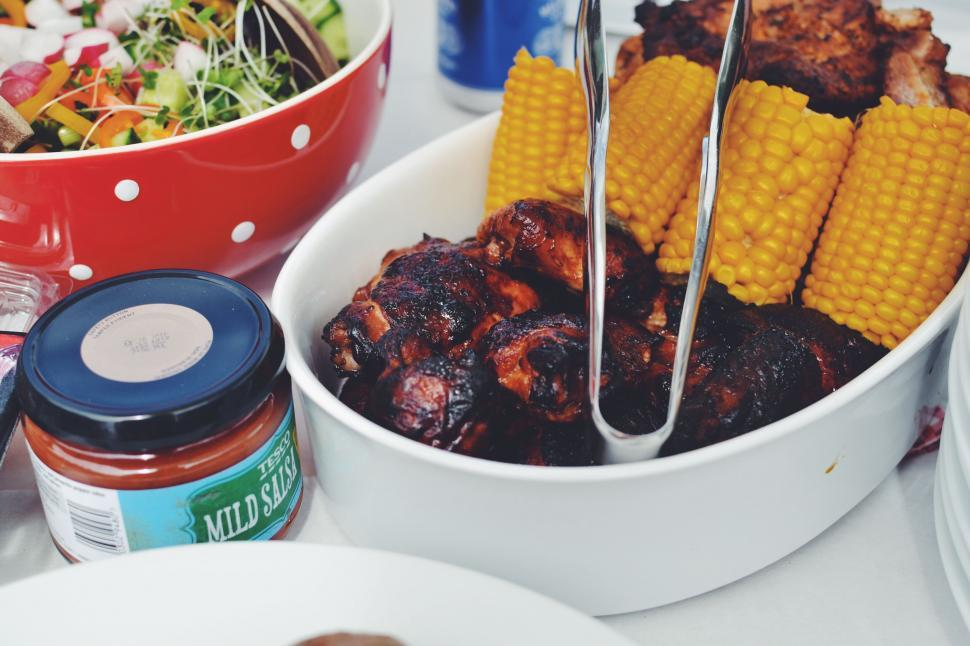 Download Free Stock HD Photo of Corn cob and grilled meat with sauce jar Online