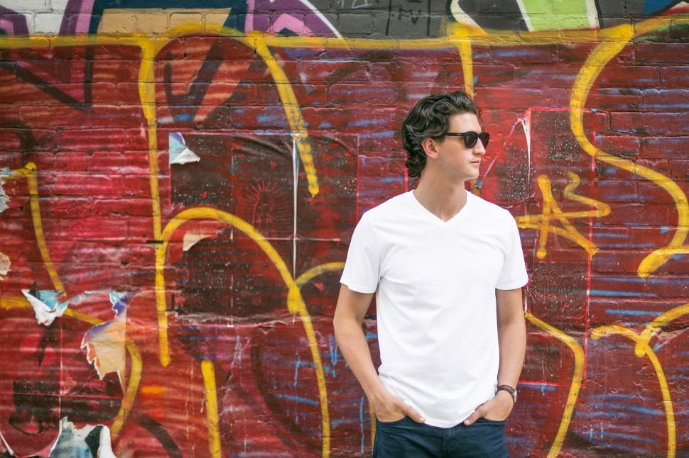Download Free Stock Photo of Caucasian Man in White T-shirt with hands in pockets