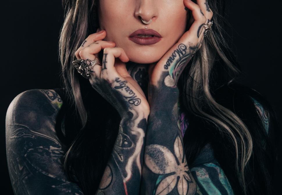 Download Free Stock Photo of Tattooed woman with nose ring