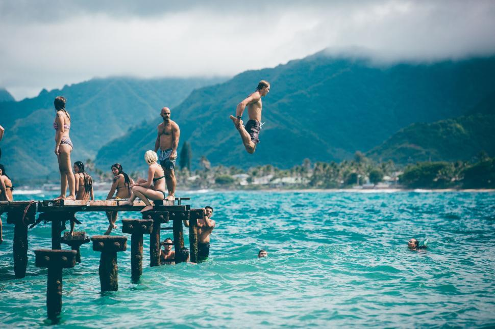 Download Free Stock Photo of People jumping into lake