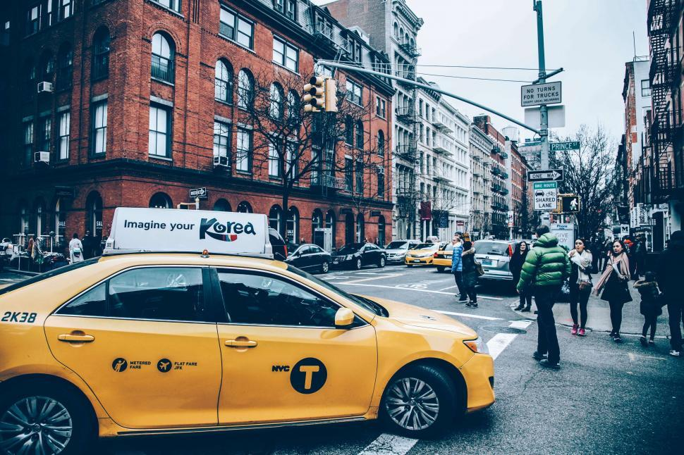 Download Free Stock Photo of Yellow Taxi at traffic signal in New York