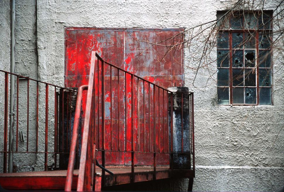 Download Free Stock Photo of Red metal doors at the top of the steps