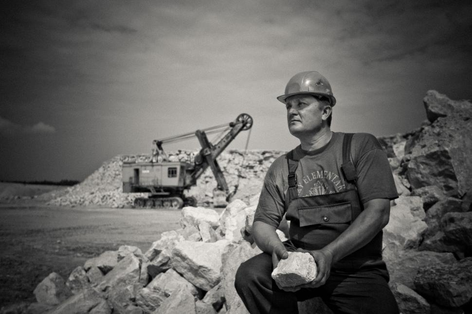 Download Free Stock Photo of Construction Worker with mine crane in the background