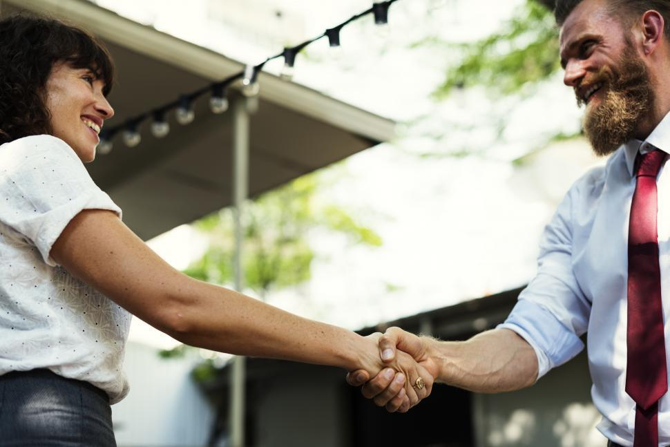 Download Free Stock HD Photo of Two people shaking hands, standing outdoors Online