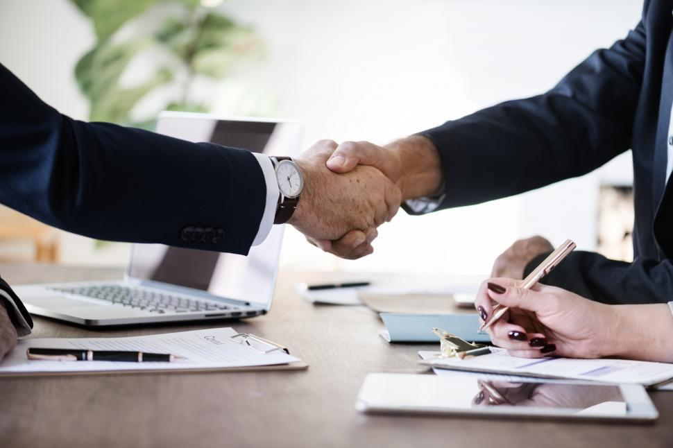 Download Free Stock Photo of Firm handshake between two business people