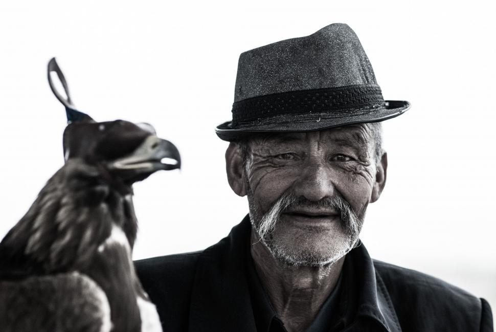 Download Free Stock Photo of Old Man in Hat with Eagle