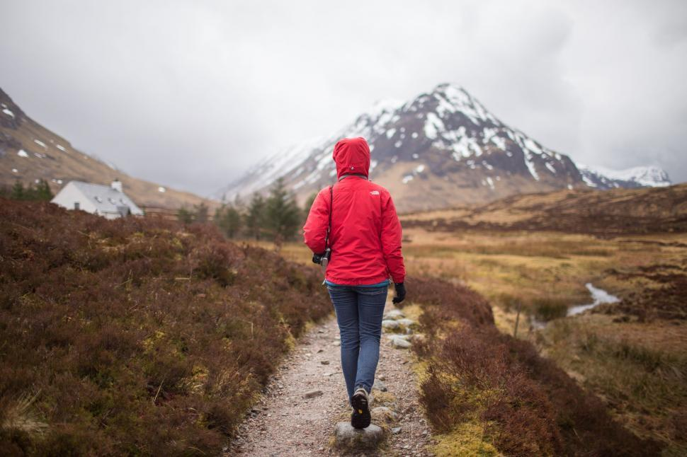 Download Free Stock Photo of Backside view of female hiker walking towards snow mountain