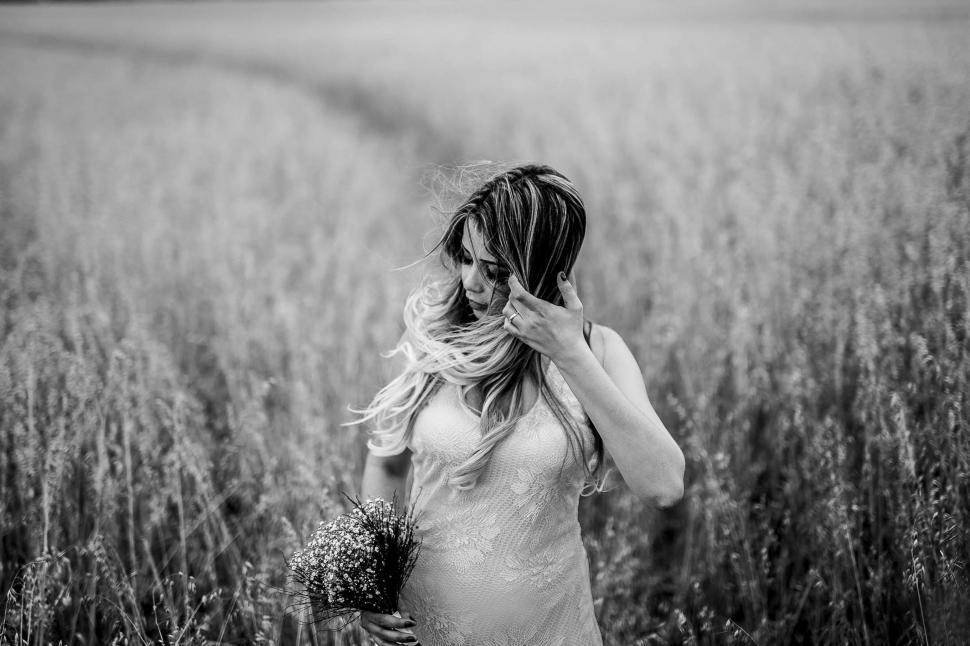 Download Free Stock Photo of Young Woman with long hair in wheat field - B&W