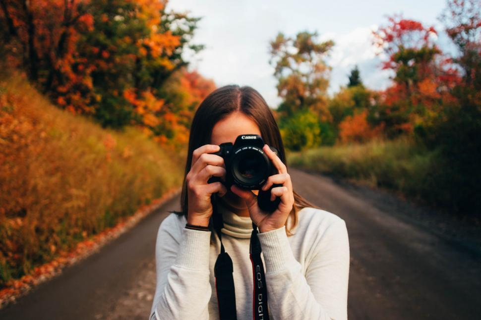 Download Free Stock Photo of Woman with Canon Camera
