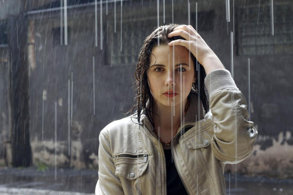 Download Free Stock Photo of Woman in rain - looking at camera