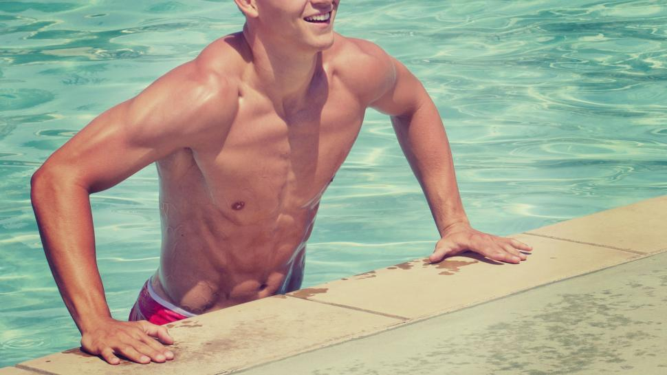 Download Free Stock Photo of Athletic body man in swimming pool