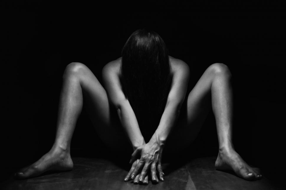 Download Free Stock Photo of Dark View of Naked Woman with hands in front on black background