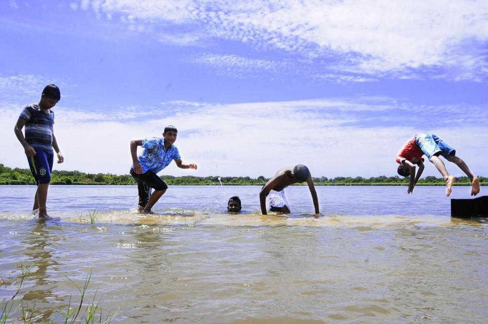 Download Free Stock Photo of Indian Men Bathing in Village River