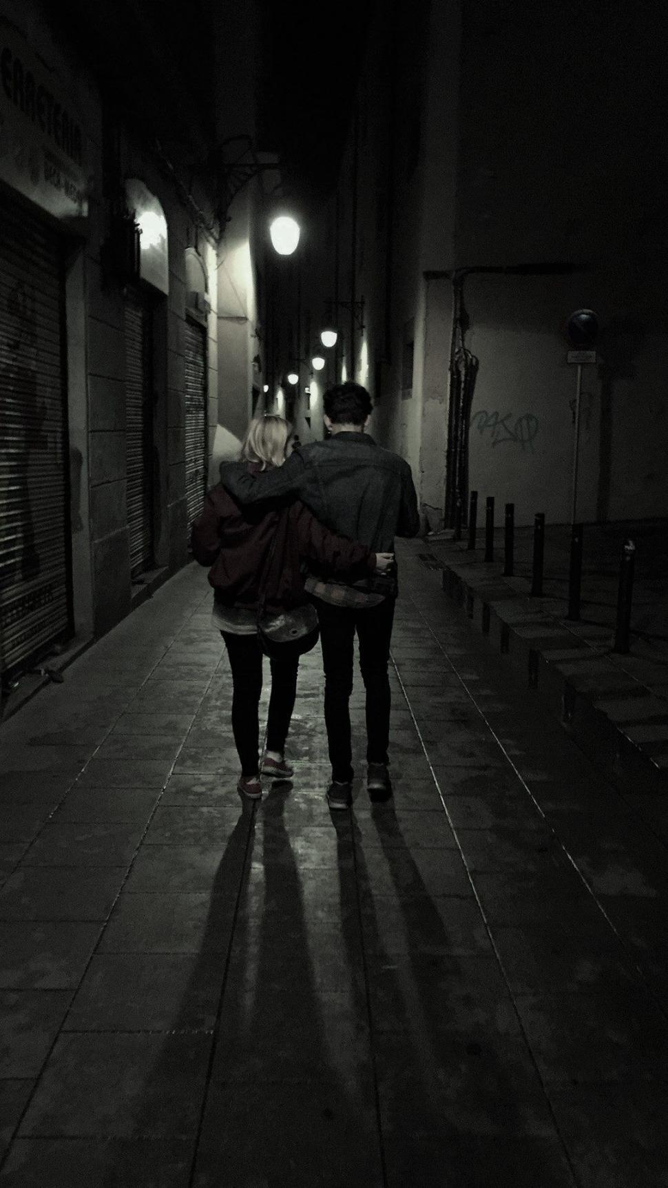 Download Free Stock Photo of Back view of couple in the alley
