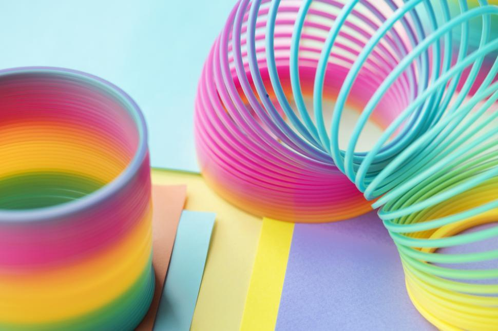 Download Free Stock Photo of Close up of colorful slinkys coiled and uncoiled