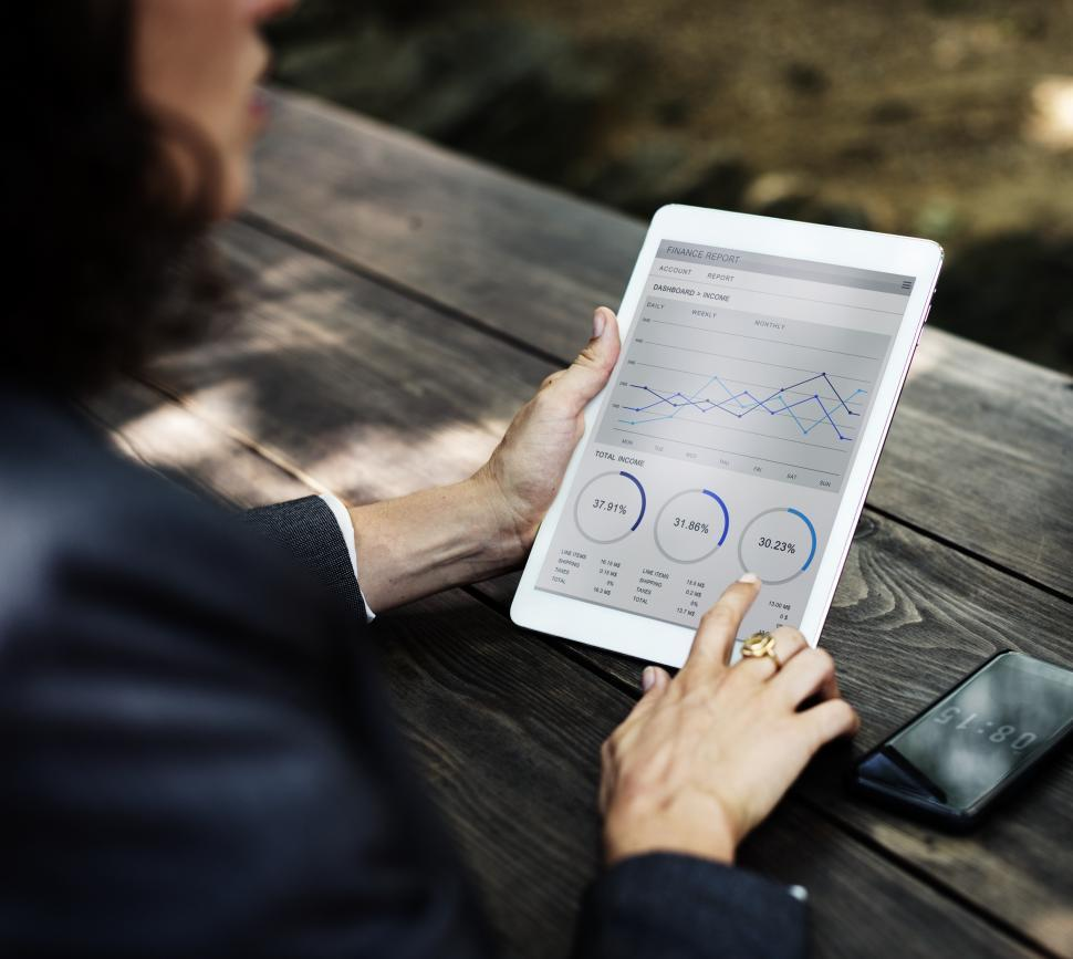 Download Free Stock Photo of Close up of a tablet device displaying business charts and graphs