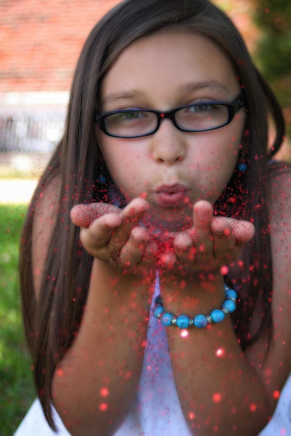 Download Free Stock Photo of Woman Blowing Red Glitter