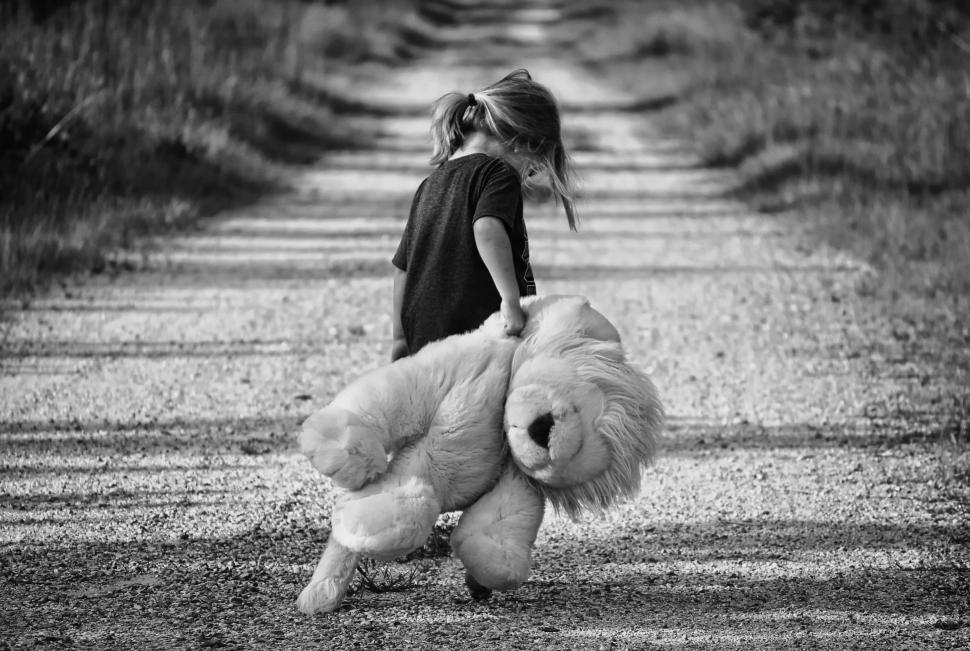 Download Free Stock Photo of Black and White View of Little Girl Walking With Teddy Bear