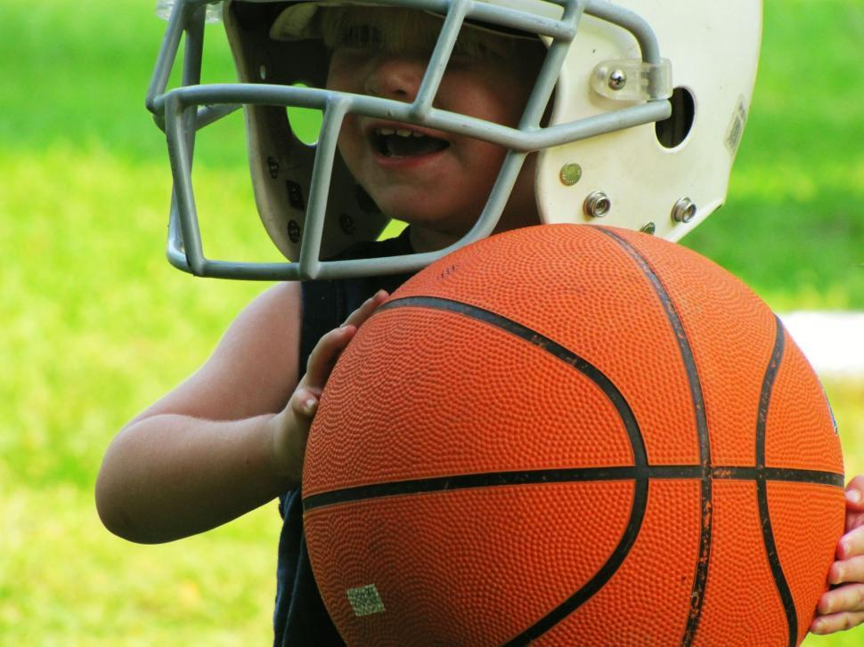 Download Free Stock Photo of Little Kid in Helmet with Basketball