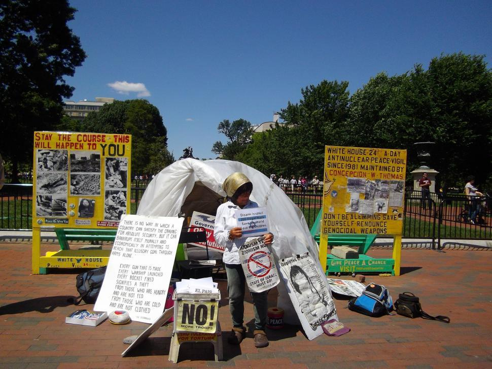 Download Free Stock Photo of Protester with banners - Anti Nuclear Peace Vigil