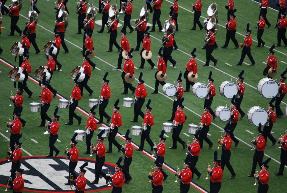 Download Free Stock Photo of Marching band members in red and black uniforms