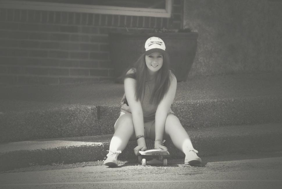 Download Free Stock Photo of Woman with Skateboard - Looking at camera