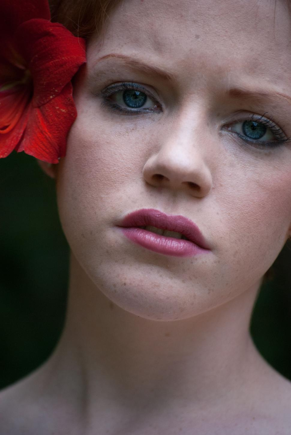 Download Free Stock Photo of Woman Face With Red Flower