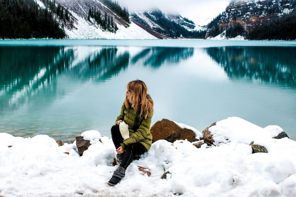 Download Free Stock Photo of Woman and Lake Louise With Snow Mountains - Banff National Park