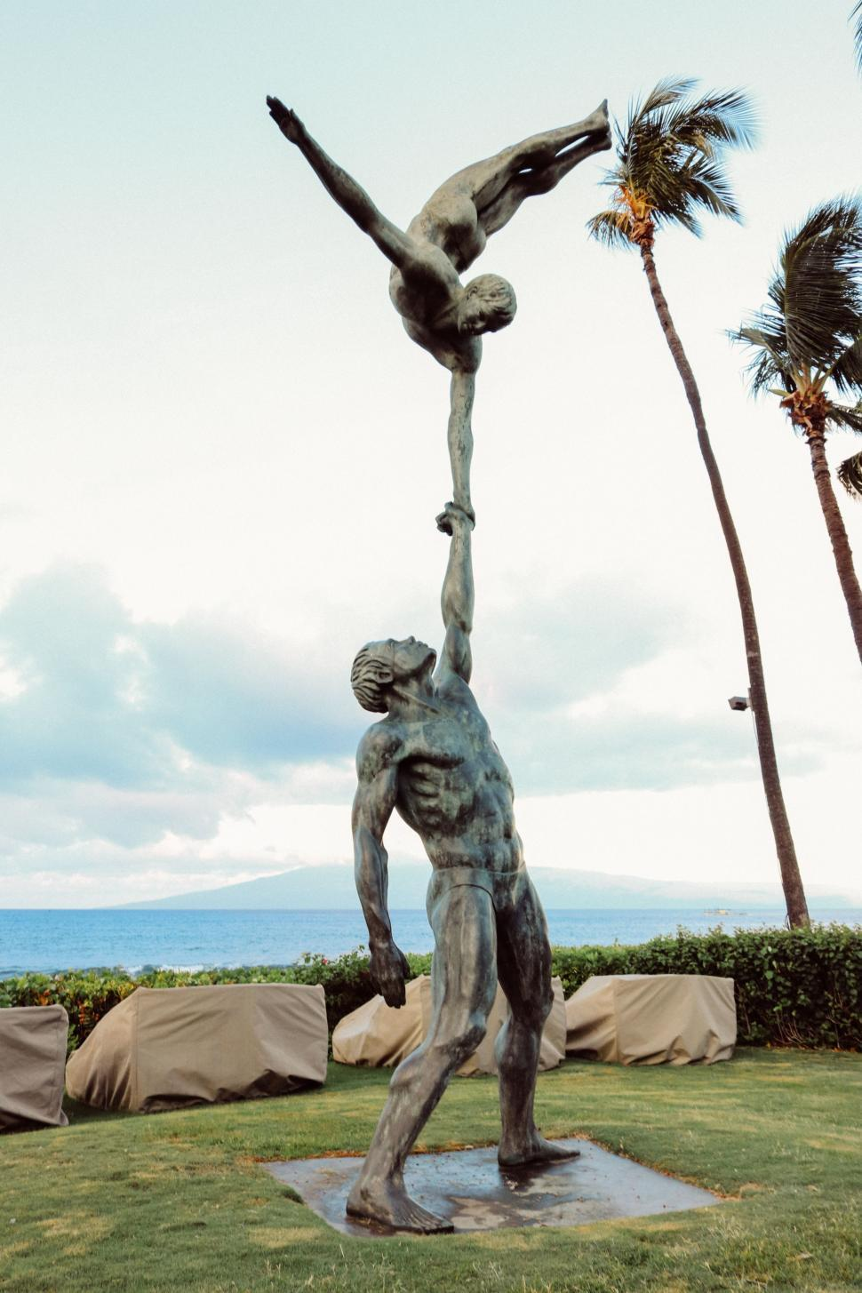 Download Free Stock Photo of The Acrobats statue with ocean and sky in the background