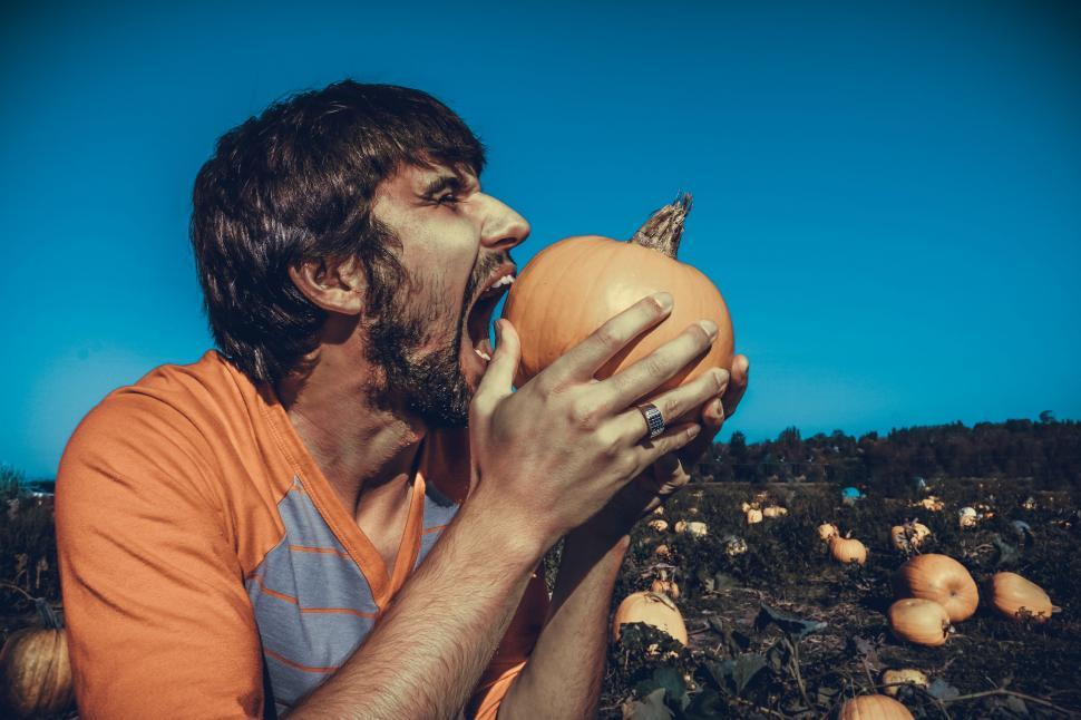 Download Free Stock Photo of Man With Open Mouth And Pumpkin