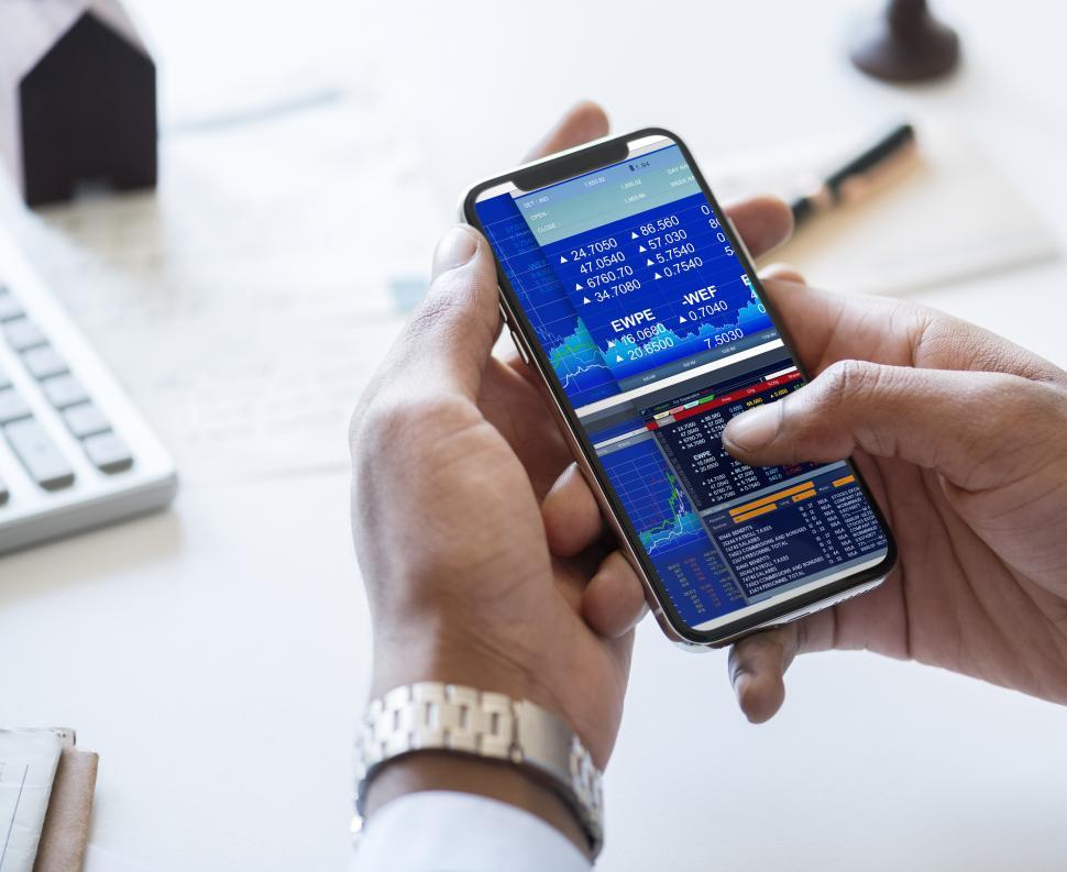 Download Free Stock Photo of Close up operating a mobile phone, viewing data