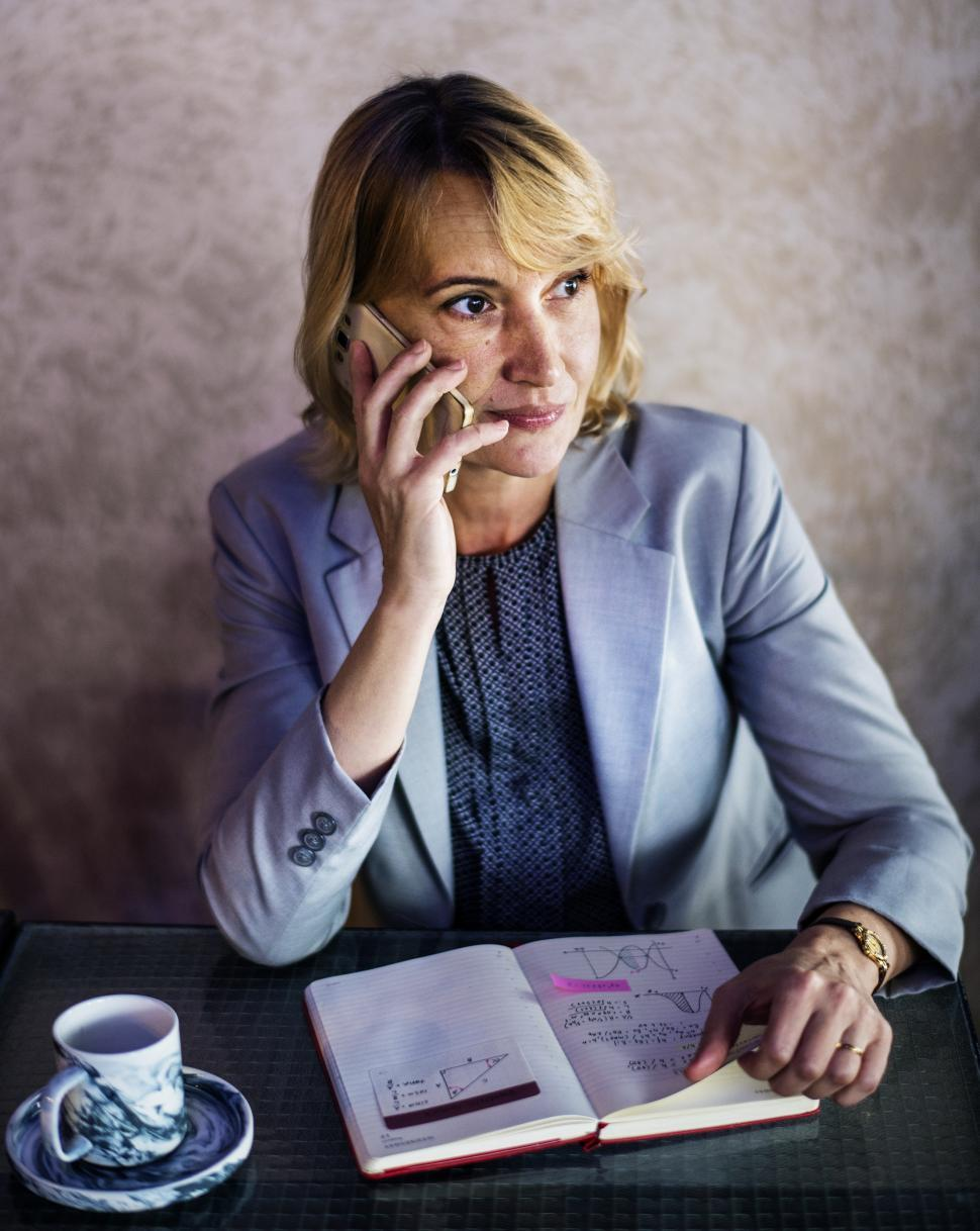 Download Free Stock Photo of A Caucasian woman taking call on her mobile phone