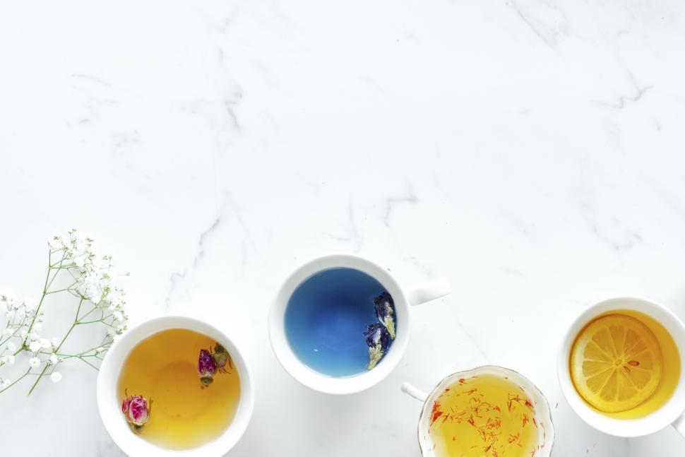 Download Free Stock HD Photo of Flat lay of cups of herbal tea with copyspace Online